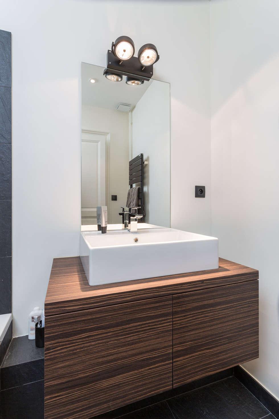Rénovation d'un appartement à Lyon 6e: Salle de bains de style  par Stellati Rénovation