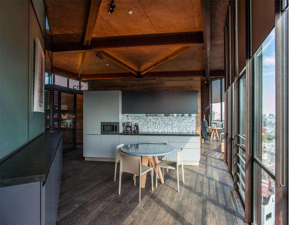 Cocina: Oficinas y tiendas de estilo  por Cm2 Management