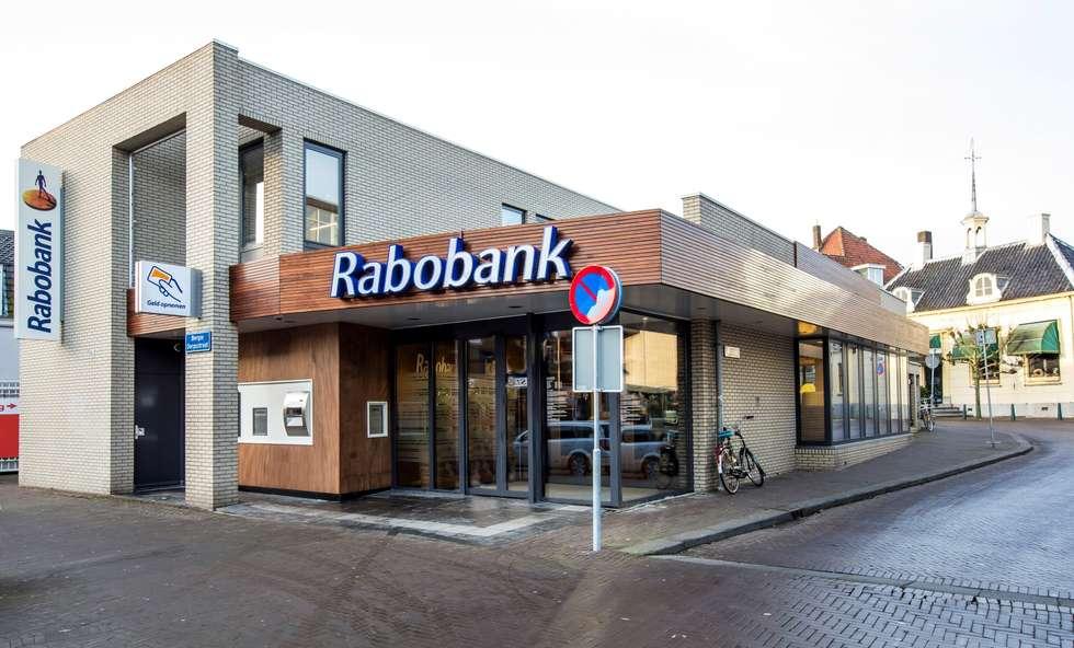 Bankgebebouw, renovatie gevel:  Kantoor- & winkelruimten door maria haag architectuur