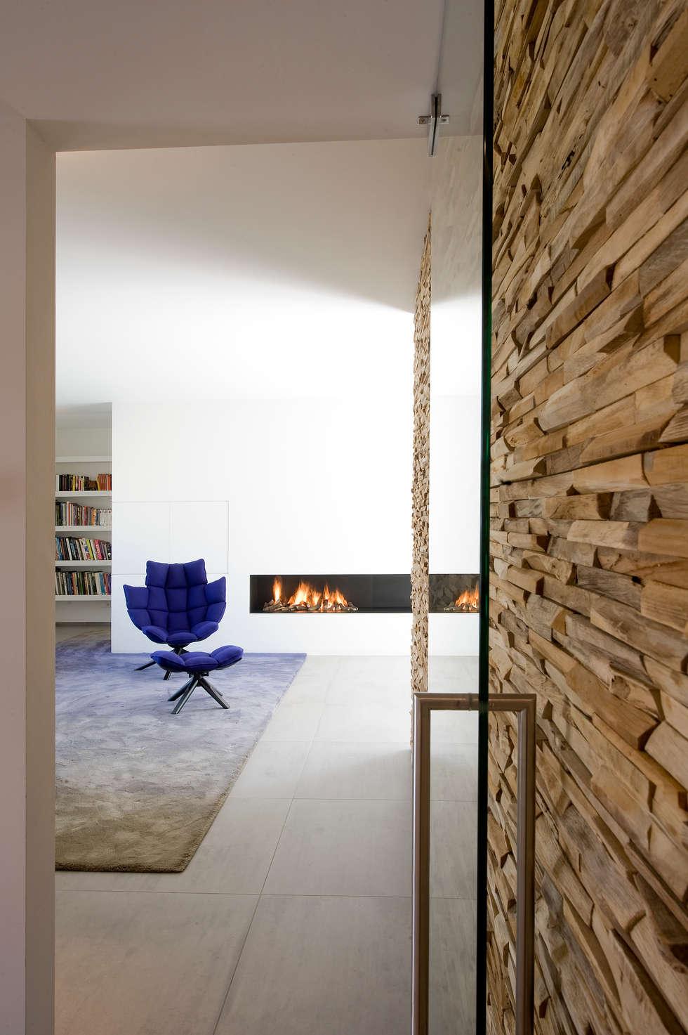 Residential Villa: moderne Woonkamer door Wonderwall Studios