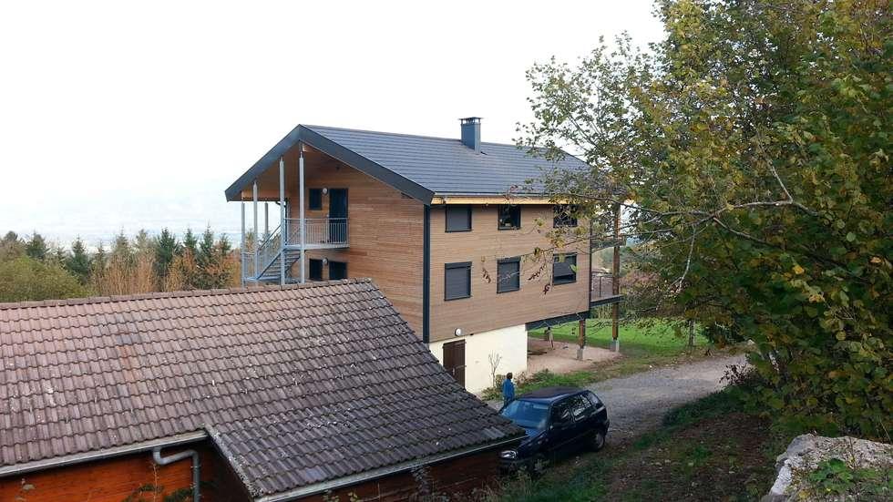 Le nouveau chalet : les façades Nord et Ouest.: Maisons de style de style Moderne par Sarl Rémy Guesné Architecte