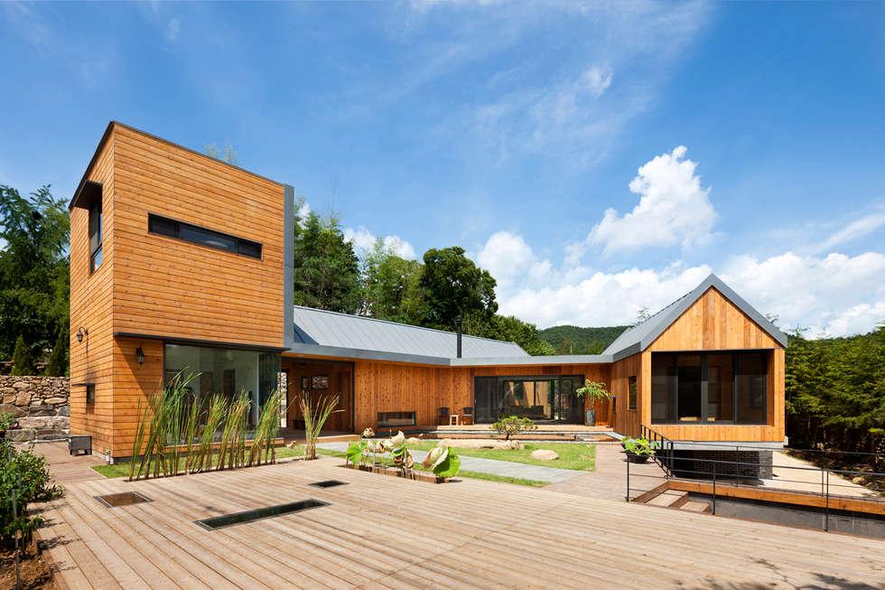 Ssangdalri House: hyunjoonyoo architects의  주택