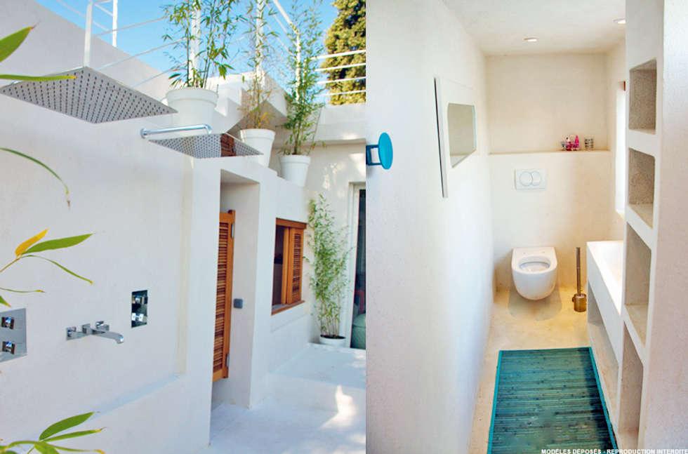 Villa Porto Vecchio: Salle de bains de style  par STUDIO LOUISMORGAN