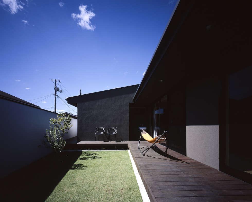 吉備津の家-okayama-: タカオジュン建築設計事務所-JUNTAKAO.ARCHITECTS-が手掛けた庭です。