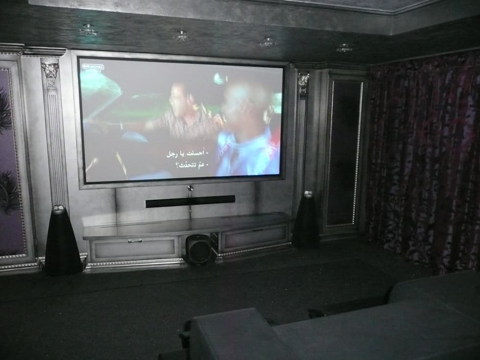 Home Cinema: Sala multimediale in stile  di Architetturambiente st.ass. Bosi e Soloni