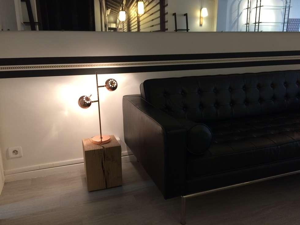 Décoration de l'Accueil d'un Spa à Pa: Espaces commerciaux de style  par At Ome