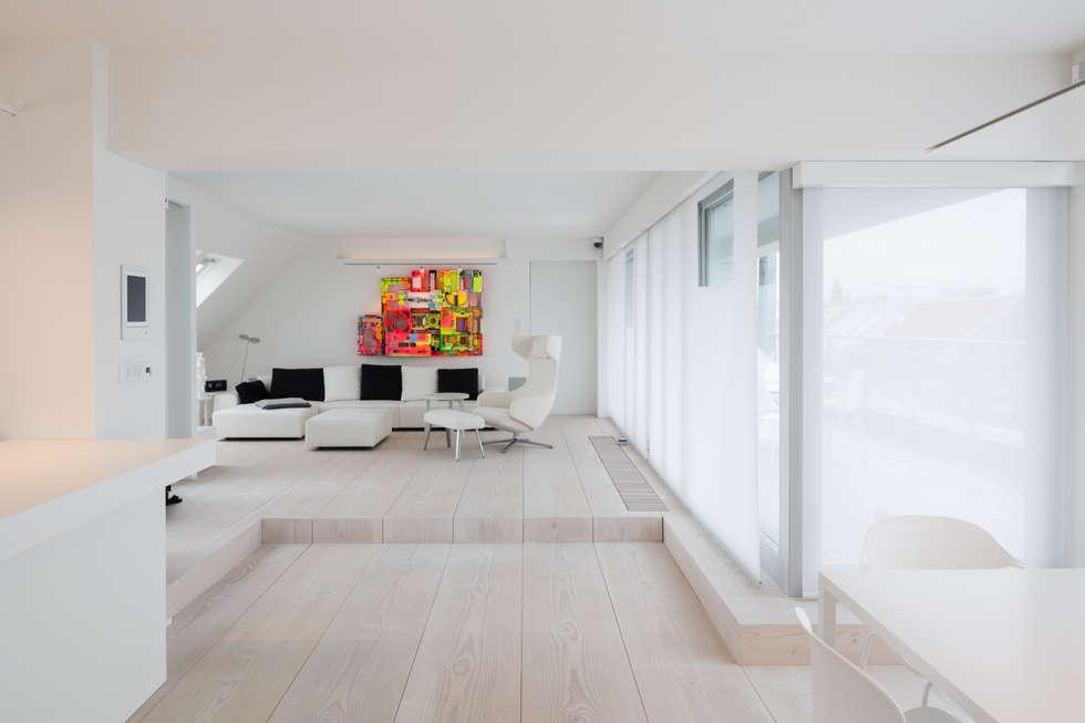 Podest Wohnzimmer, wohnraum mit podest: moderne wohnzimmer von goderbauer architects, Design ideen