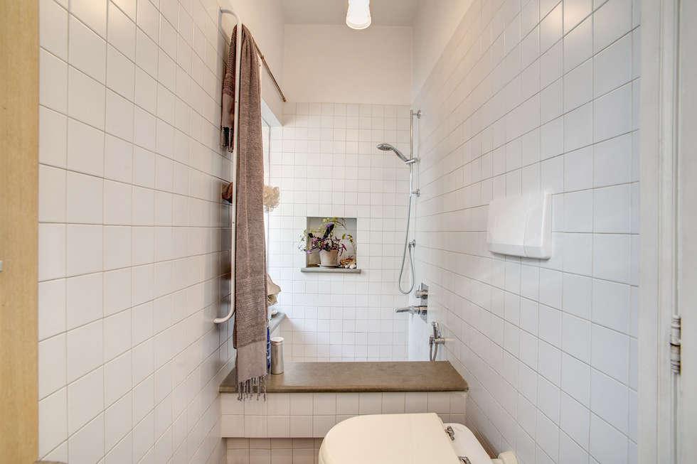SUBURRA : Bagno in stile in stile Moderno di MOB ARCHITECTS