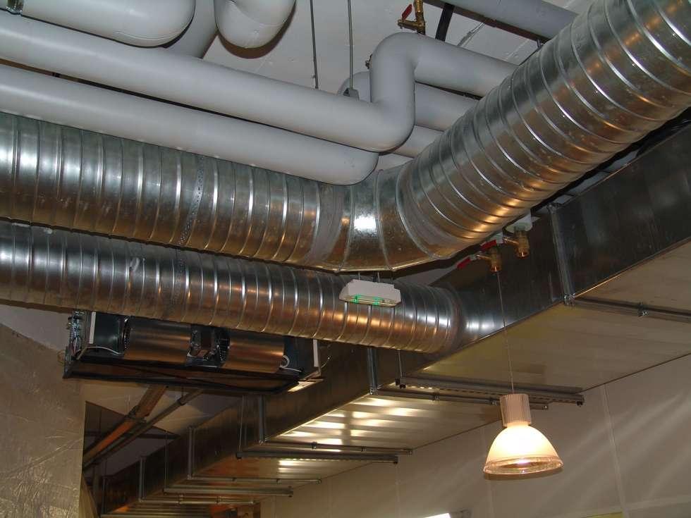 système de ventilation: Locaux commerciaux & Magasins de style  par Carabox SARL