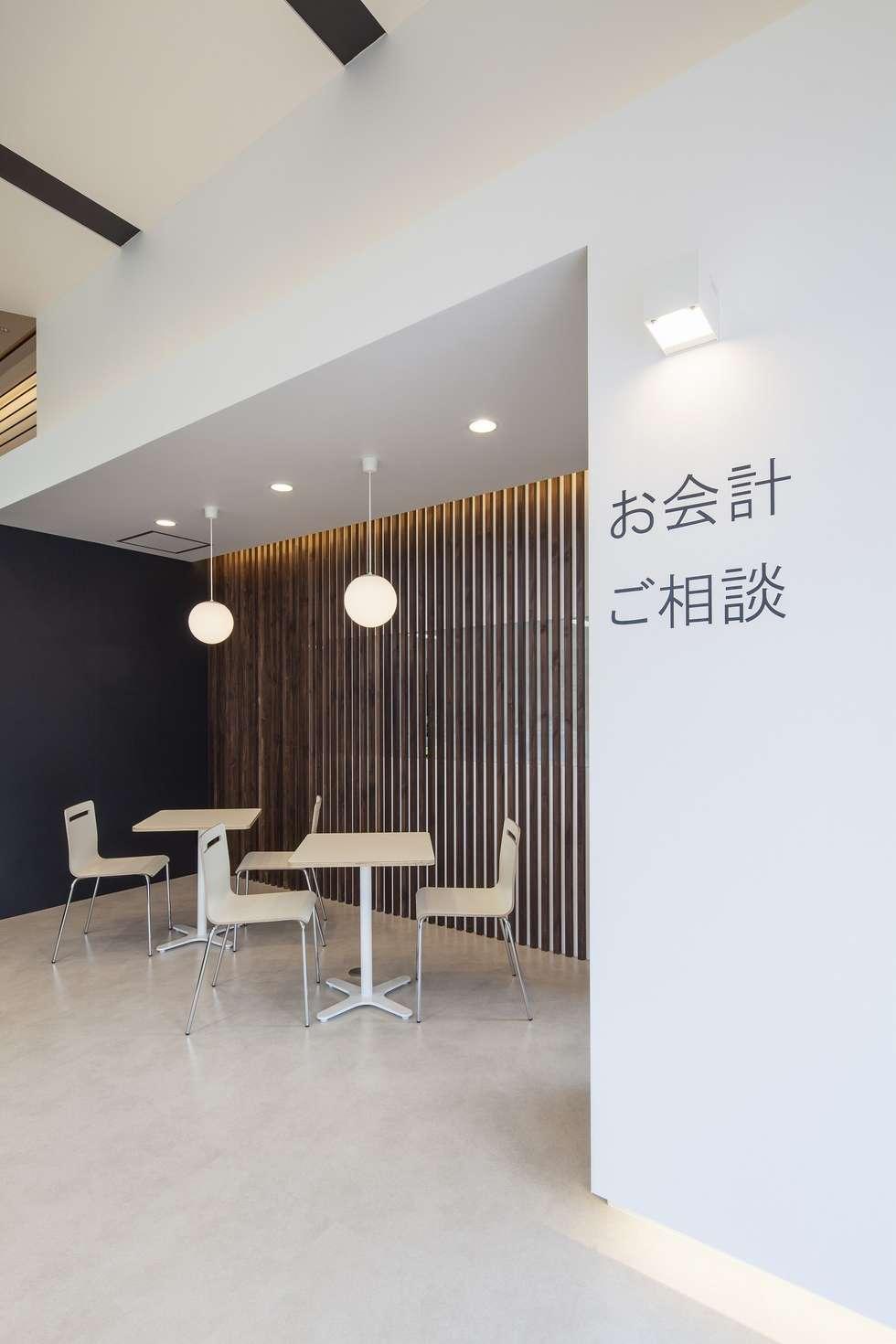 会計コーナー: 有限会社ミサオケンチクラボが手掛けた商業空間です。