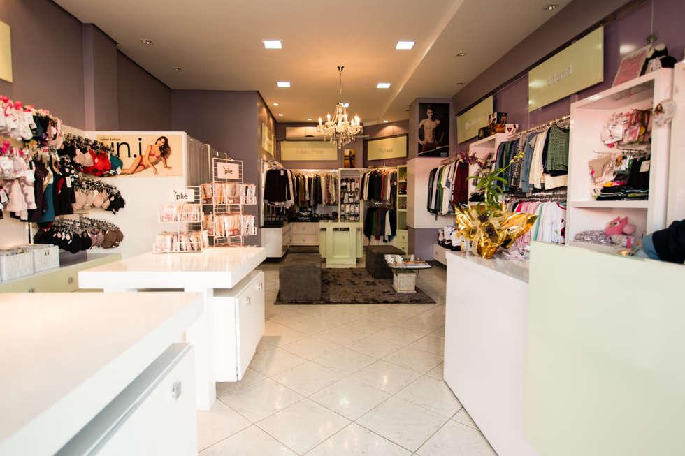 ARTE & SEDUÇÃO STORE: Lojas e imóveis comerciais  por Veridiana Negri Arquitetura