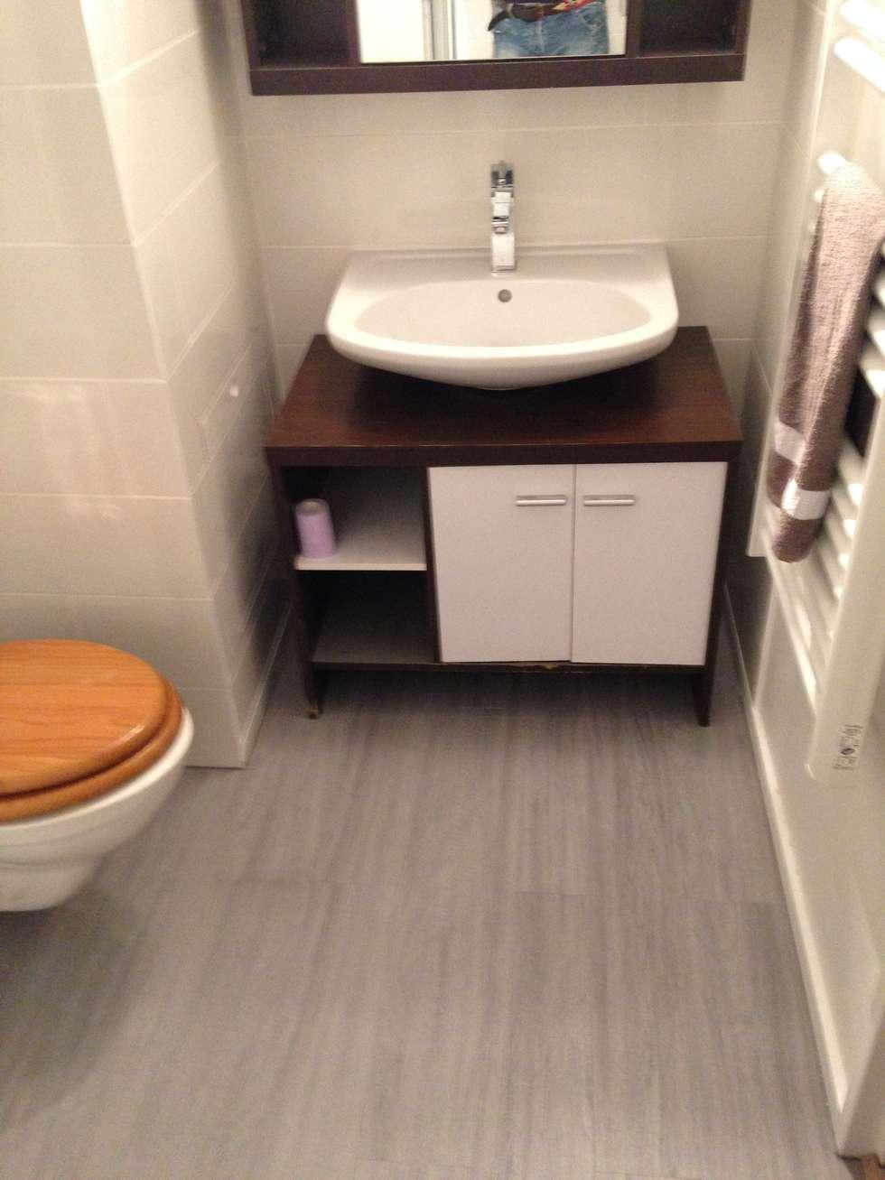 vasque de lavabo posée sur meuble: Salle de bains de style  par Em3w