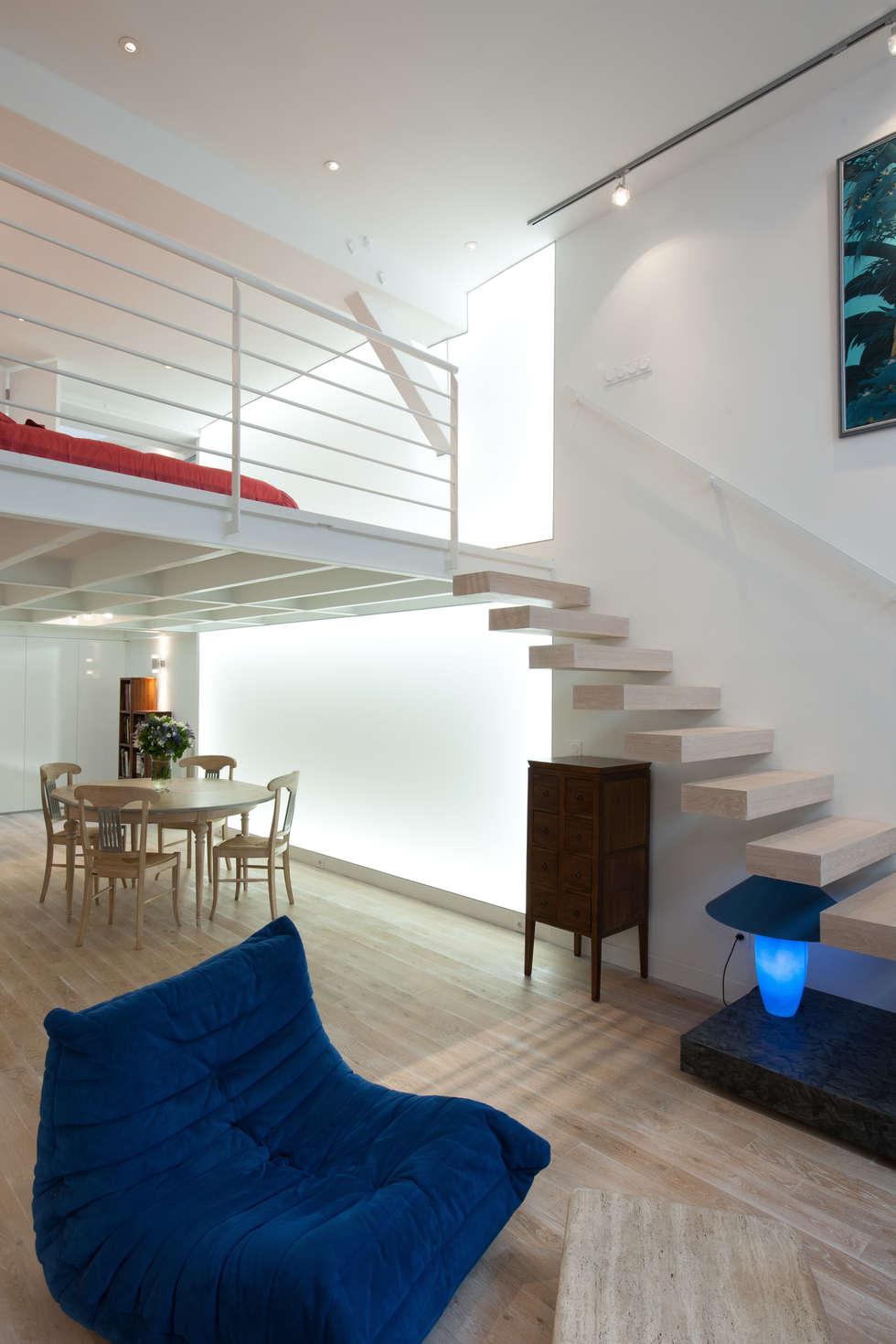 Mur de lumière: Salon de style de style Minimaliste par Fables de murs