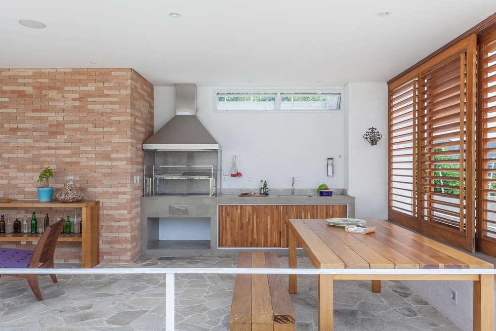 Residência Parque dos Príncipes: Terraços  por Nautilo Arquitetura & Gerenciamento