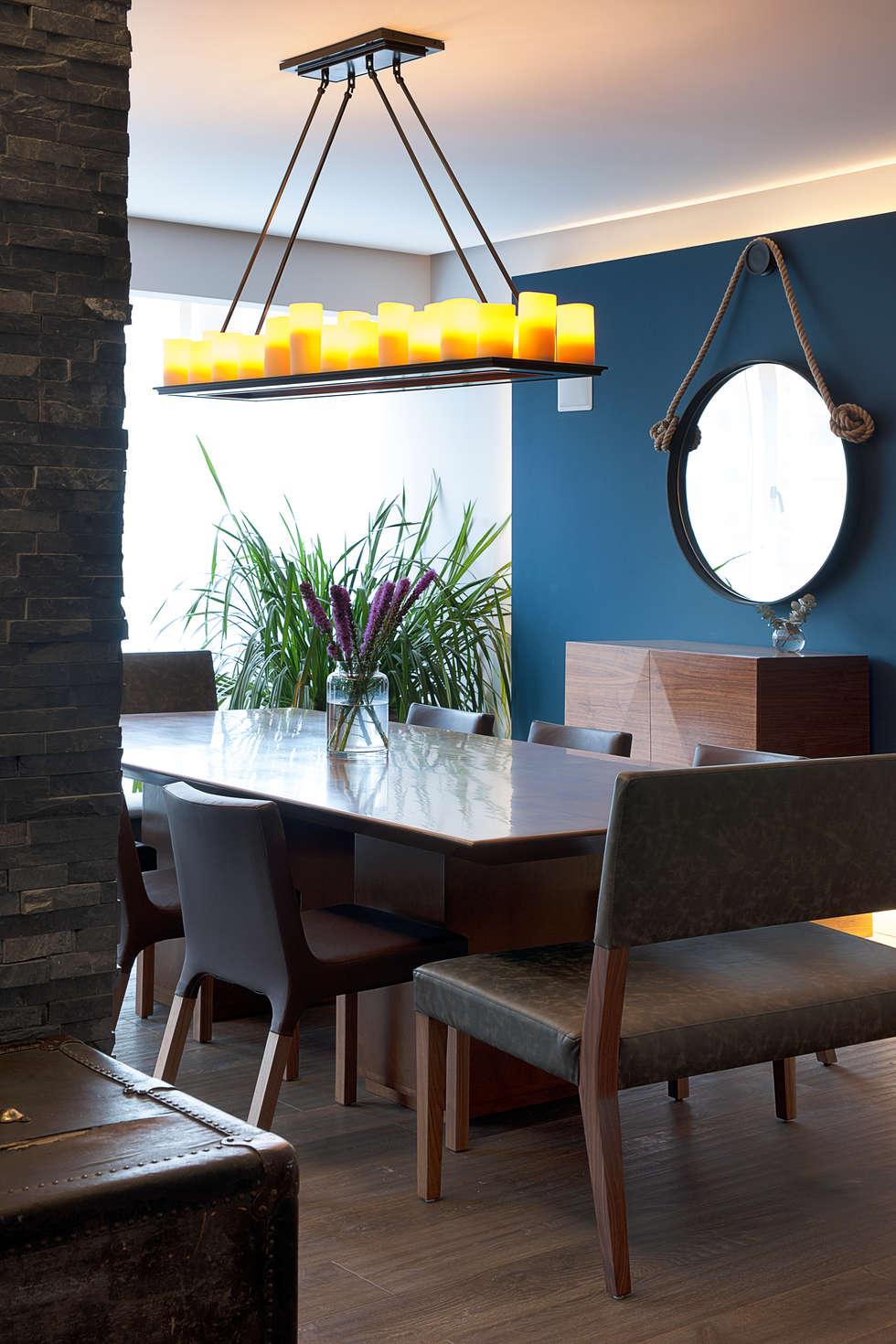 Departamento DL: Comedores de estilo moderno por kababie arquitectos