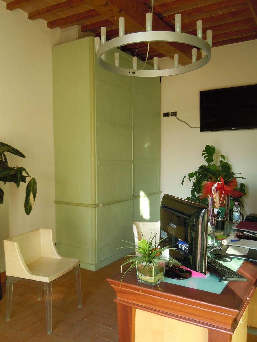 reception hotel: Hotel in stile  di Maurizio Andruetto  Monica Deri    Architetti Associati