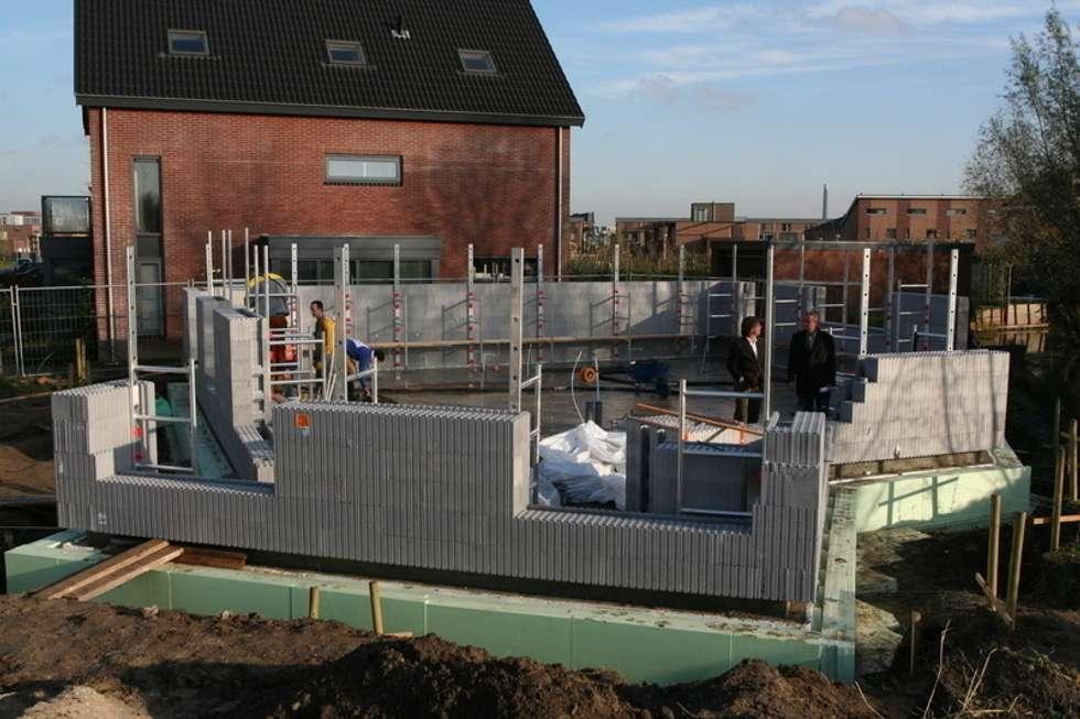 het project in uitvoering: moderne Huizen door Villa Delphia