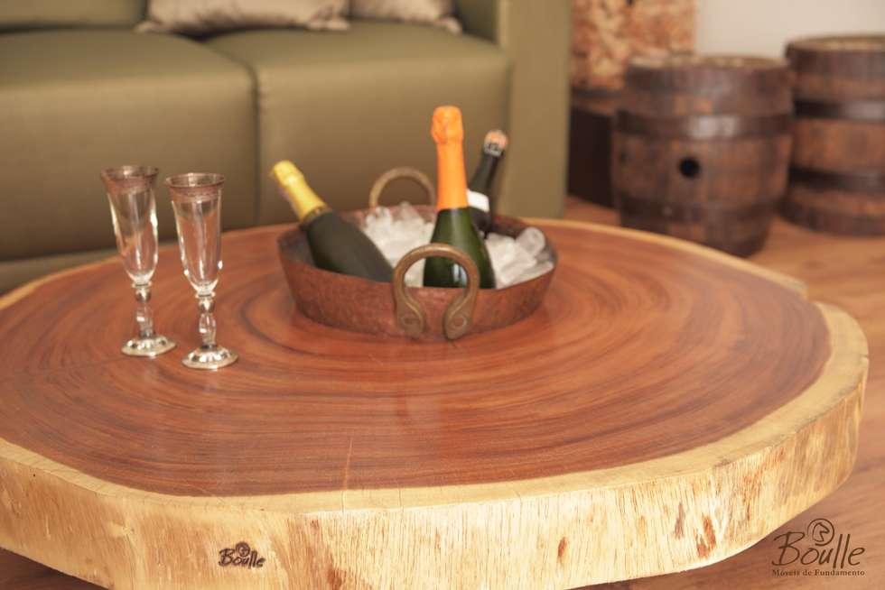 Mesa de centro com champanheira: Adegas rústicas por Boulle