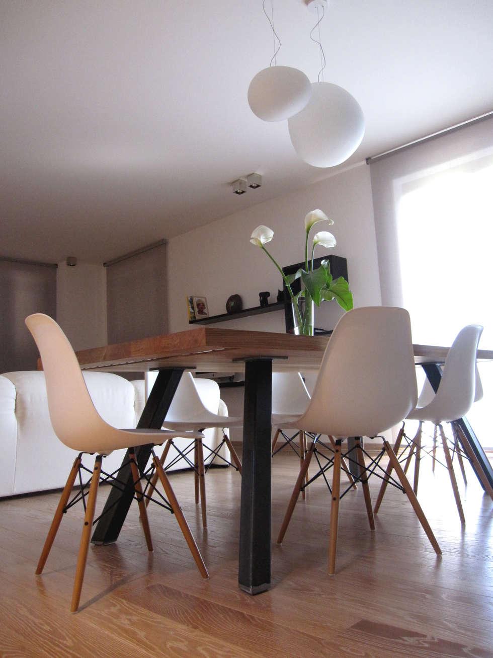 zona pranzo: Sala da pranzo in stile in stile Moderno di studio radicediuno