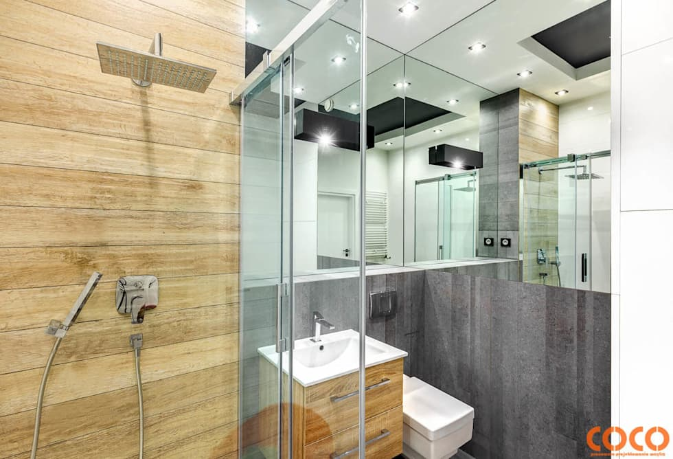 Bliźniacze lustrzane łazienki: styl , w kategorii Łazienka zaprojektowany przez COCO Pracownia projektowania wnętrz
