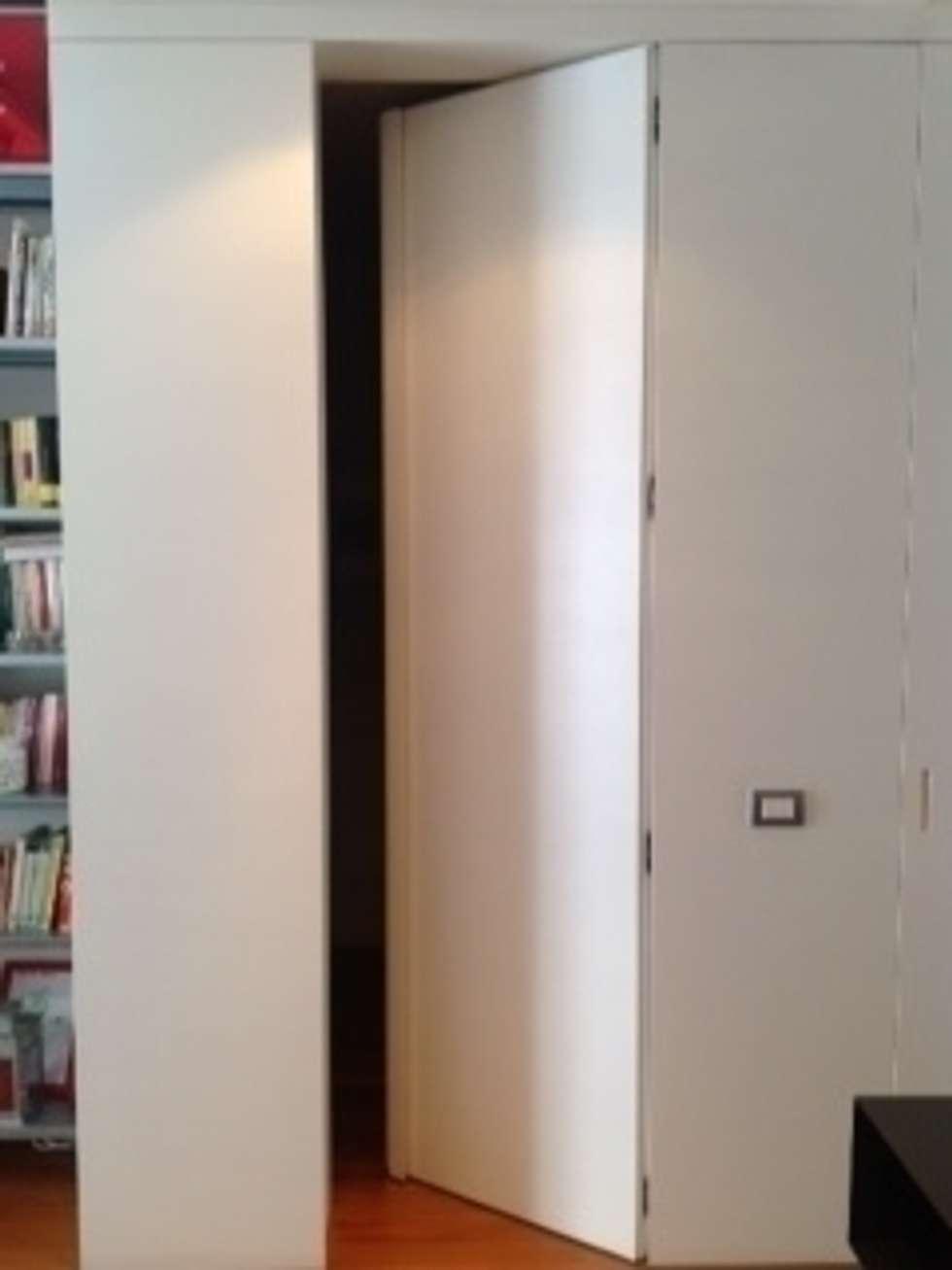parete in legno : Sala da pranzo in stile in stile Minimalista di nicoletta simonti architetto