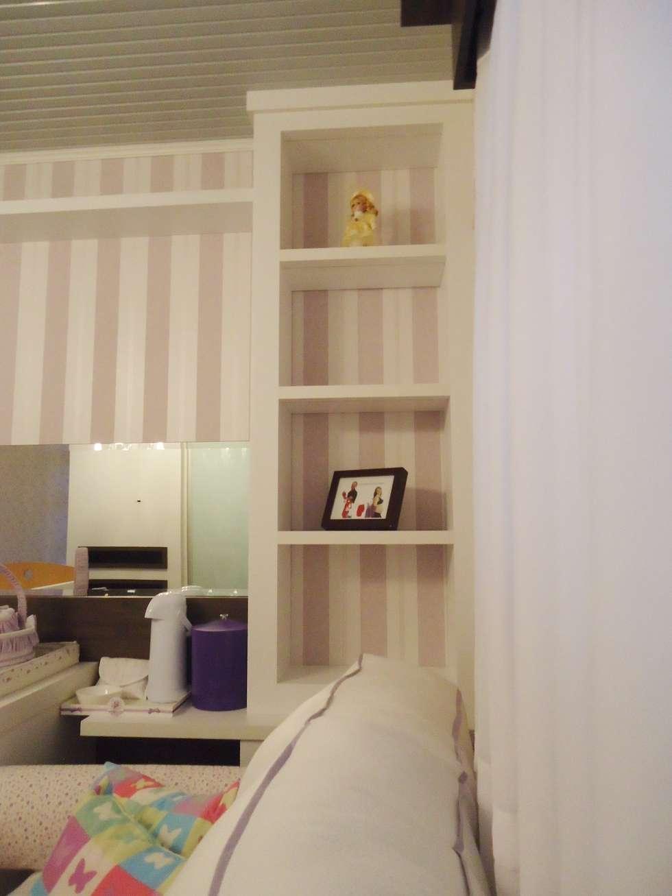 Arquitetura de interiores - Dormitório de bebê menina: Quarto infantil  por Ésse Arquitetura e Interiores