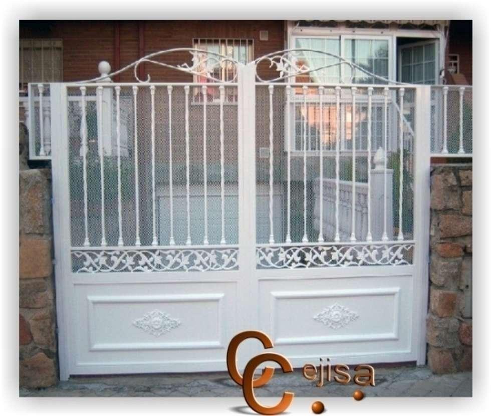 Puerta de forja moderna ventanas de estilo de cerrajeria cejisa homify - Modelos de puertas de hierro ...