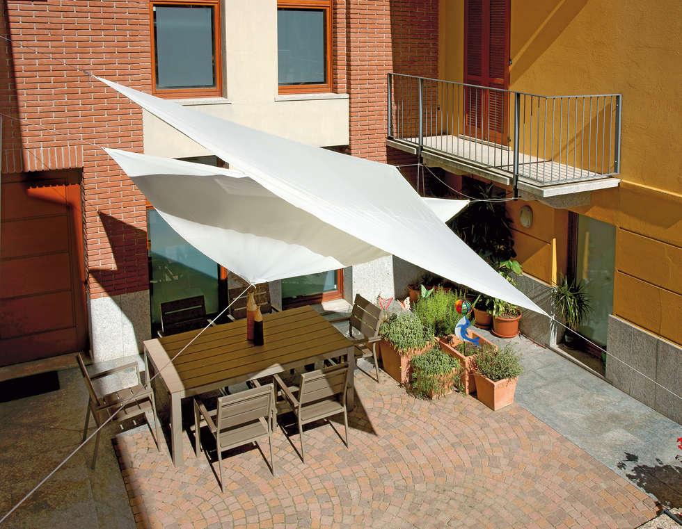 Interior design ideas redecorating remodeling photos for Toldos velas para terrazas