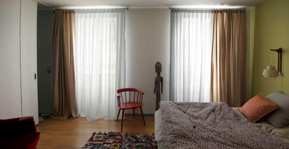 Chambre: Chambre de style de style Moderne par Atelier architecture située