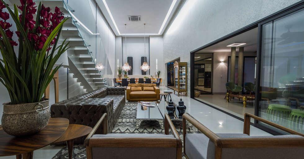 Living: Salas de jantar modernas por RABAIOLI I FREITAS
