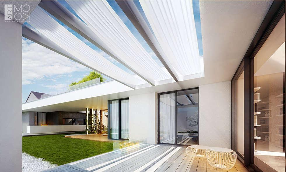 Nowoczesny dom pod Krakowem: styl nowoczesne, w kategorii Domy zaprojektowany przez Pracownia projektowa artMOKO