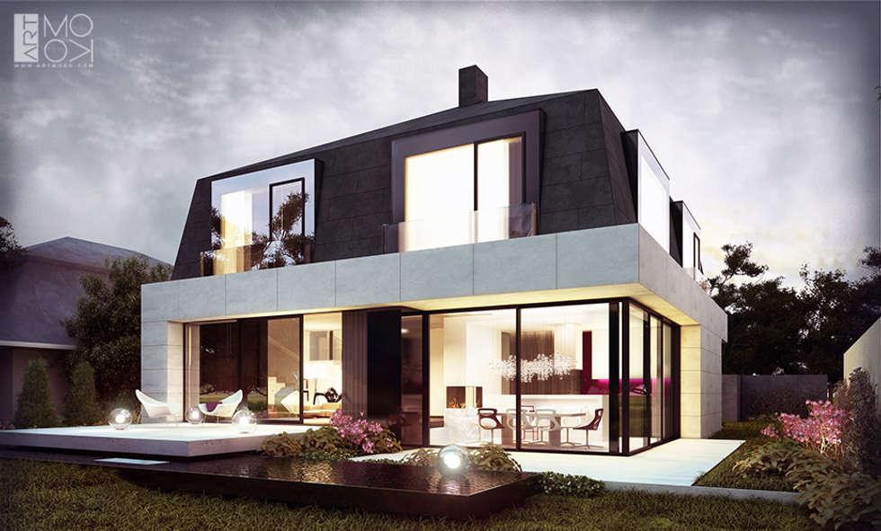Nowoczesna rezydencja z tarasami: styl nowoczesne, w kategorii Domy zaprojektowany przez Pracownia projektowa artMOKO