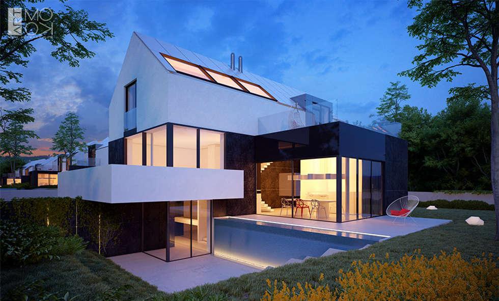 Nowoczesne połączenie domu z ogrodem: styl nowoczesne, w kategorii Domy zaprojektowany przez Pracownia projektowa artMOKO
