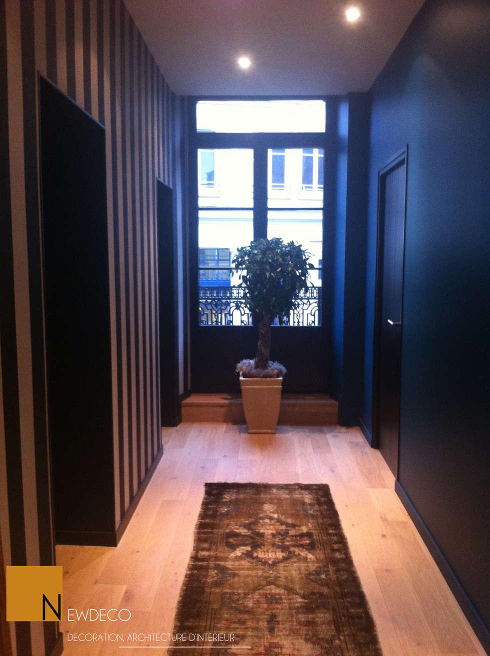 Rénovation d'un appartement centre ville Fougères: Couloir et hall d'entrée de style  par NEWDECO