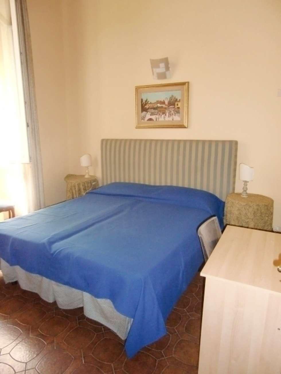 L'appartamento accanto al Duomo: Case in stile in stile Rustico di Milligan&Milligan