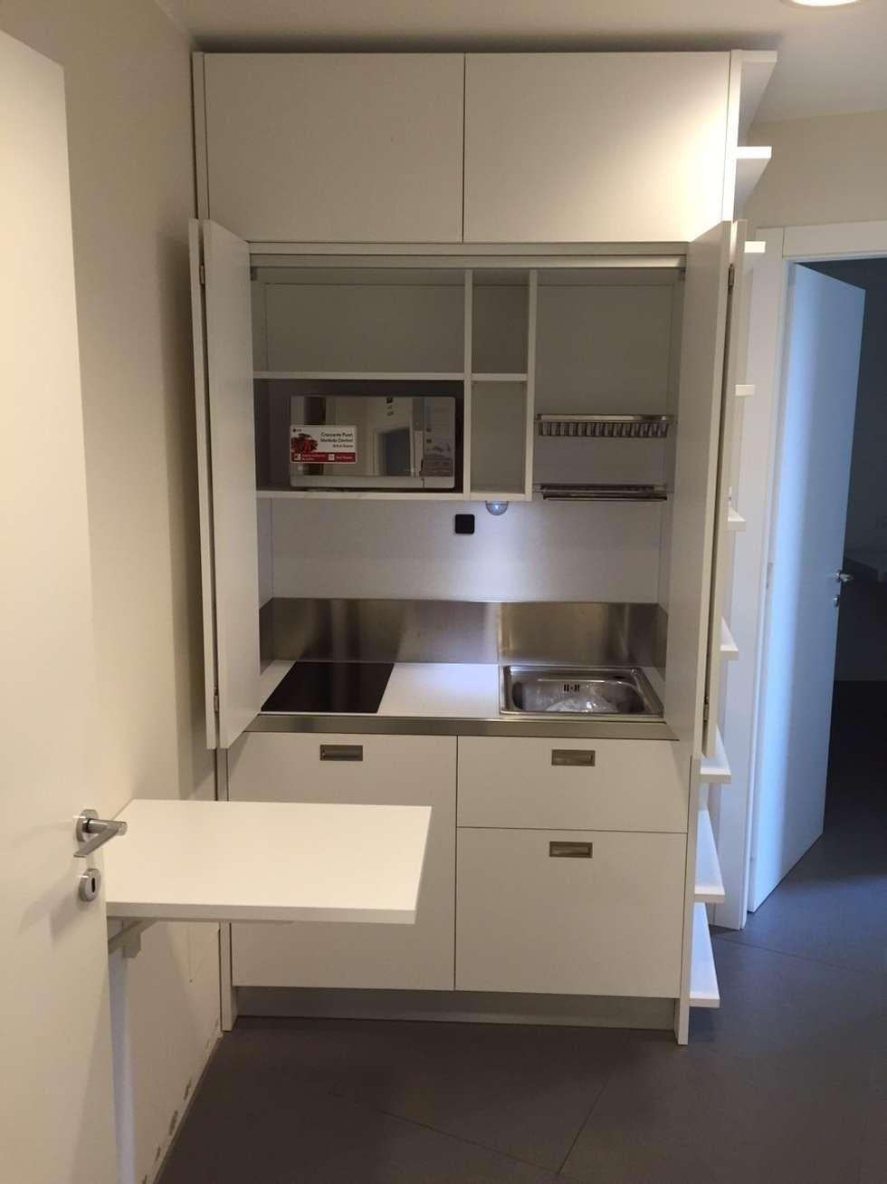Idee arredamento casa interior design homify - Cucina con tavolo a scomparsa ...