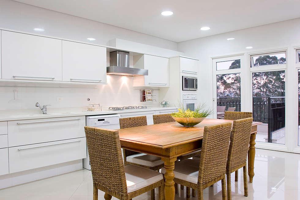 Cozinha com terraço: Cozinhas modernas por dsgnduo