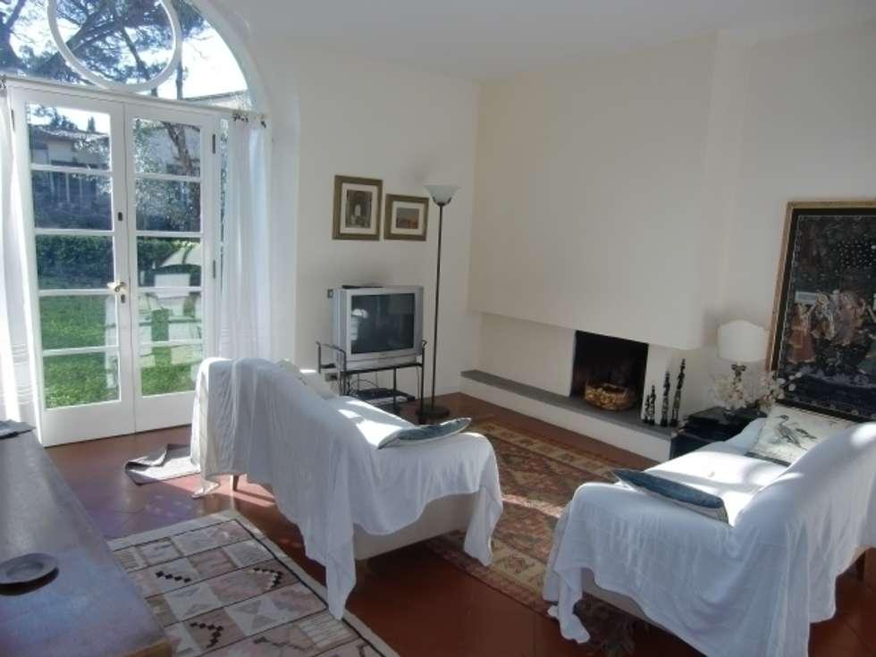 L' appartamento nel Chianti: Case in stile in stile Rustico di Milligan&Milligan
