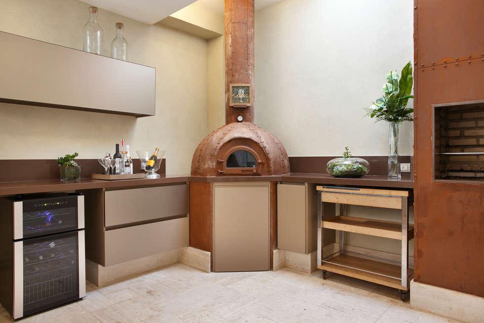 Cozinha Gourmet - churrasqueira: Cozinhas modernas por Arquitetura e Interior