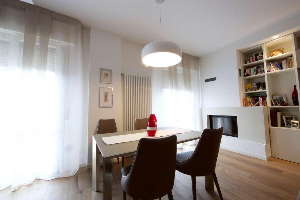 Angolo da té: sala da pranzo in stile in stile moderno di modularis ...