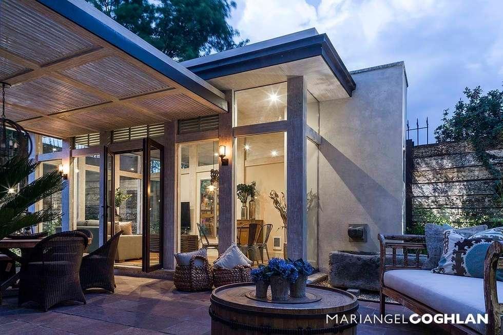 Terraza: Casas de estilo moderno por MARIANGEL COGHLAN