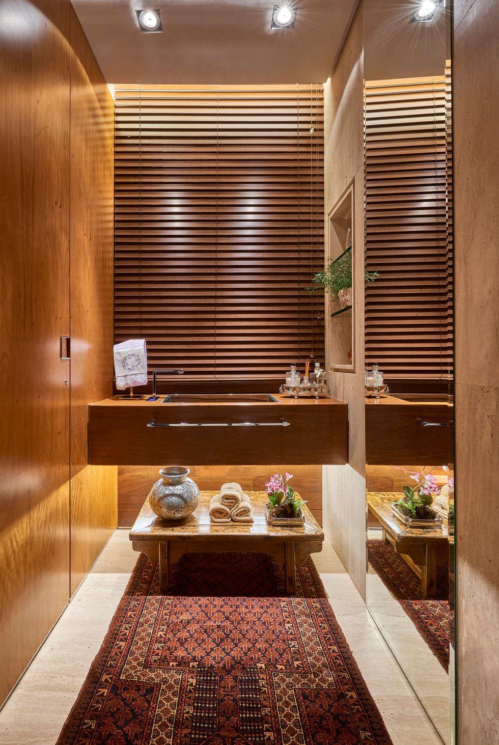 Apartamento AS: Banheiros modernos por Beth Nejm