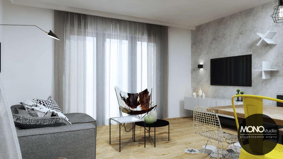 Industrialny charakter z ciepłem domowego ogniska: styl , w kategorii Salon zaprojektowany przez MONOstudio
