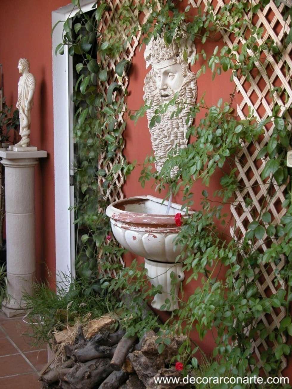 La fuente de fauno: Jardín de estilo  de Decorarconarte.com