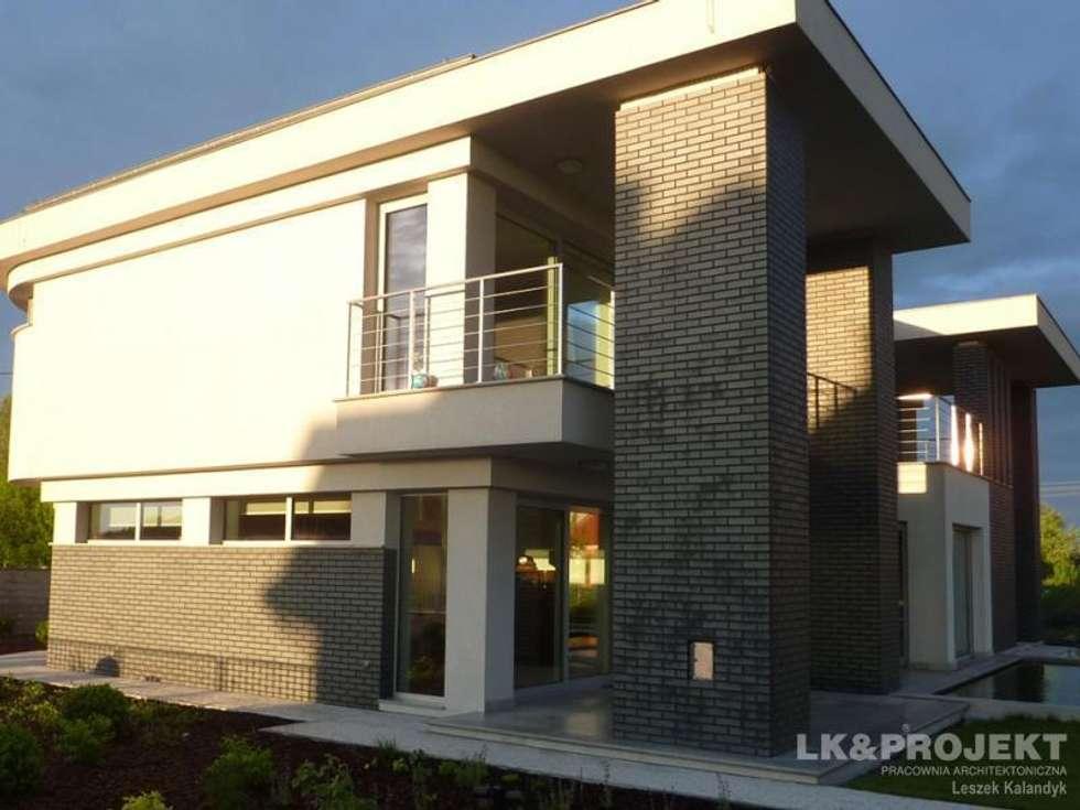 LK&803: styl nowoczesne, w kategorii Domy zaprojektowany przez LK & Projekt Sp. z o.o.