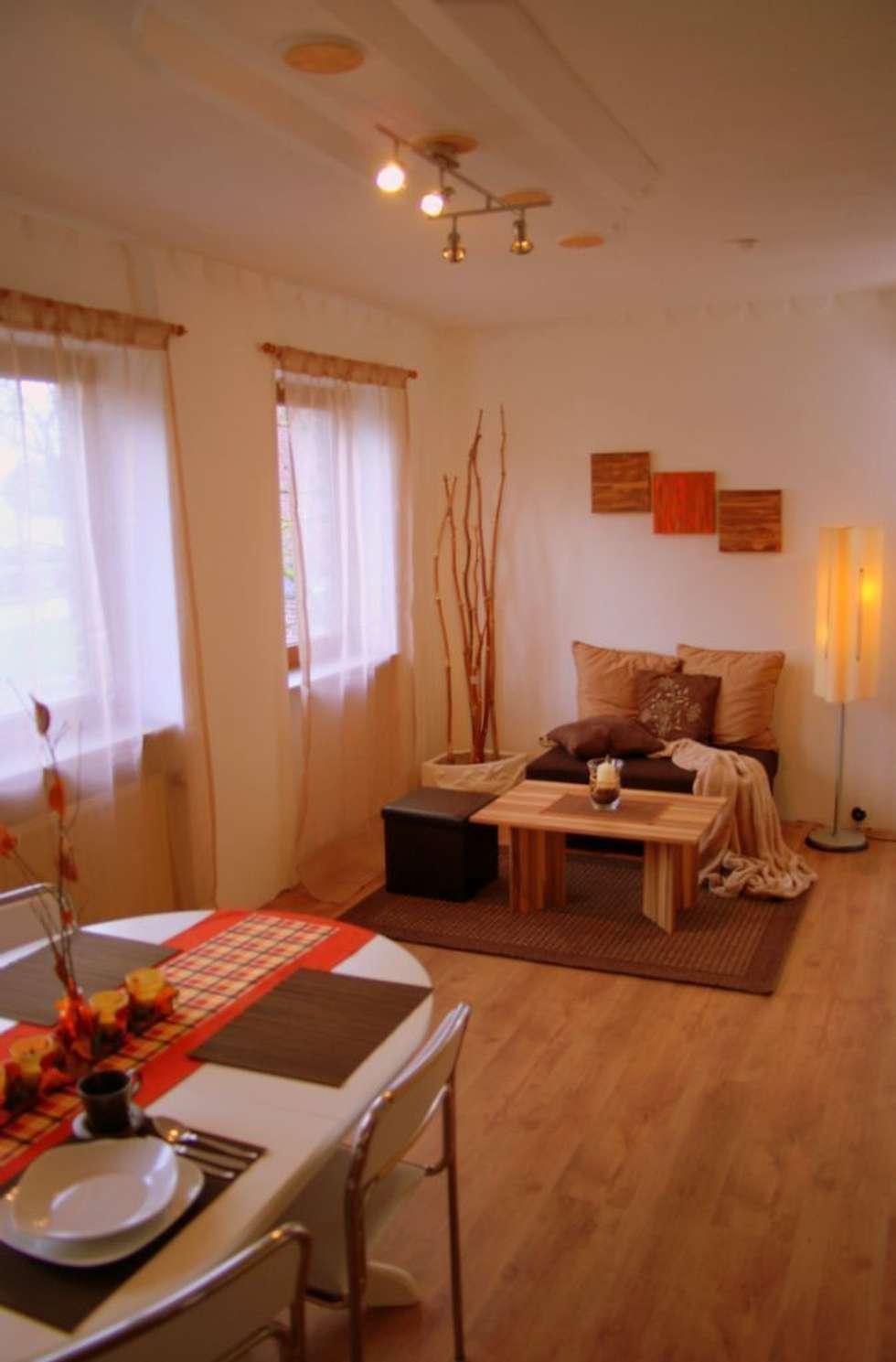 Wohnbereich Nachher: moderne Wohnzimmer von wohnausstatter