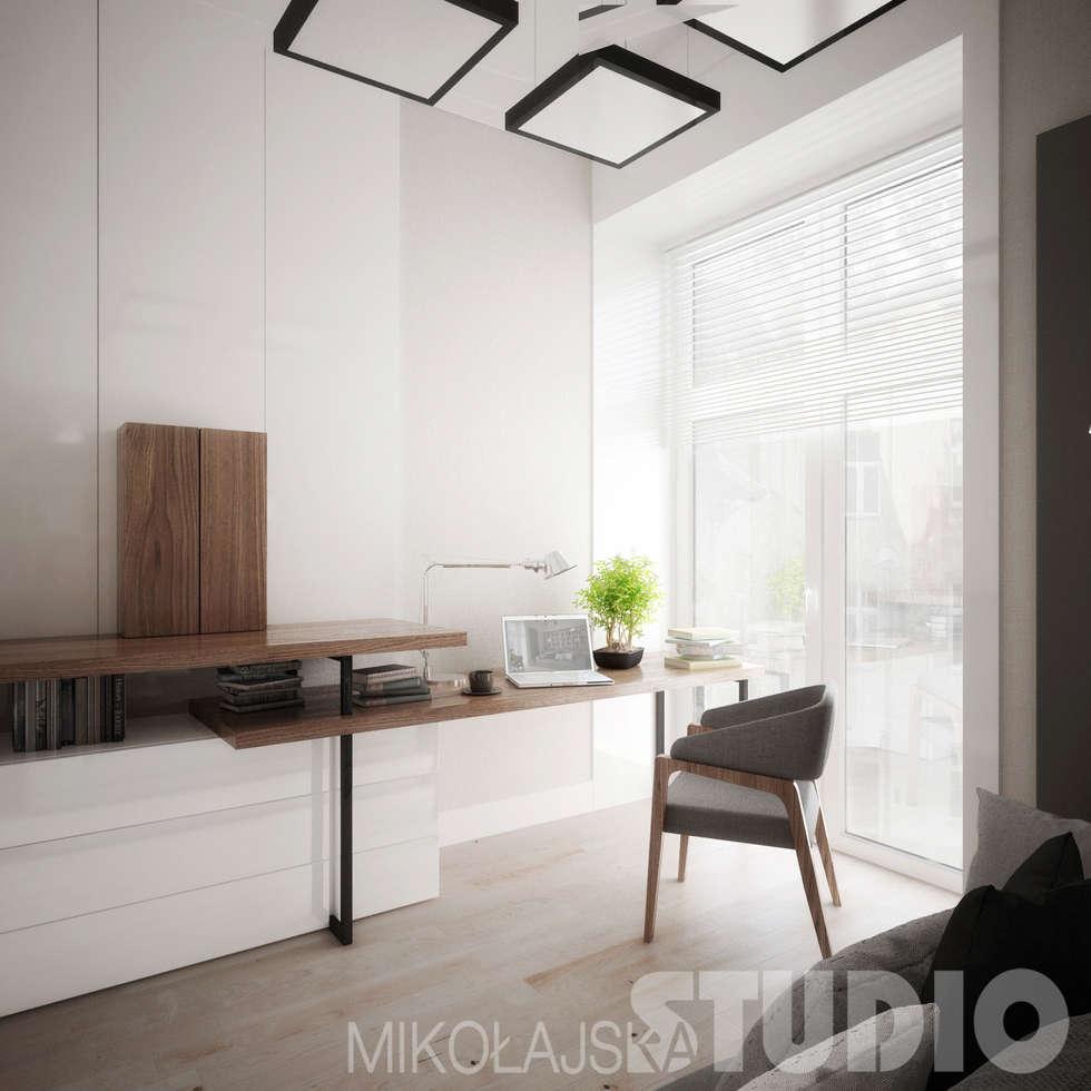 Elegancki i nowoczesny gabinet: styl , w kategorii Domowe biuro i gabinet zaprojektowany przez MIKOŁAJSKAstudio