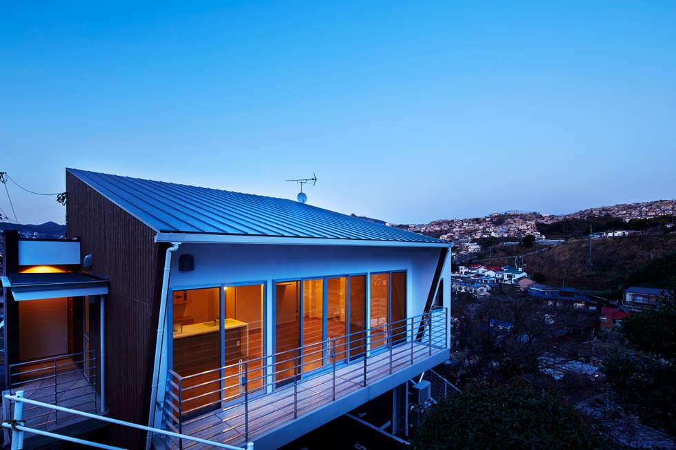Casas modernas por 岡村設計