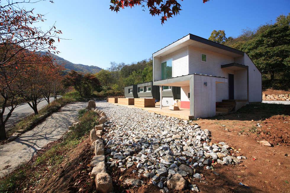 문경미니펜션의 외관: 주택설계전문 디자인그룹 홈스타일토토의  주택