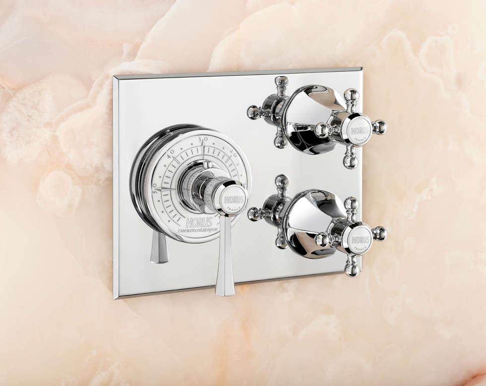 Mitigeur thermostatique à cadran: Hôtels de style  par HORUS